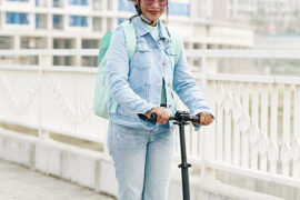 Fashionable woman on electric scooter